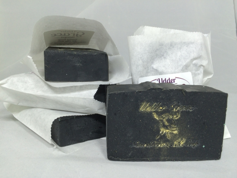 facial soap with goat milk, activated charcoal, neem, and tea tree