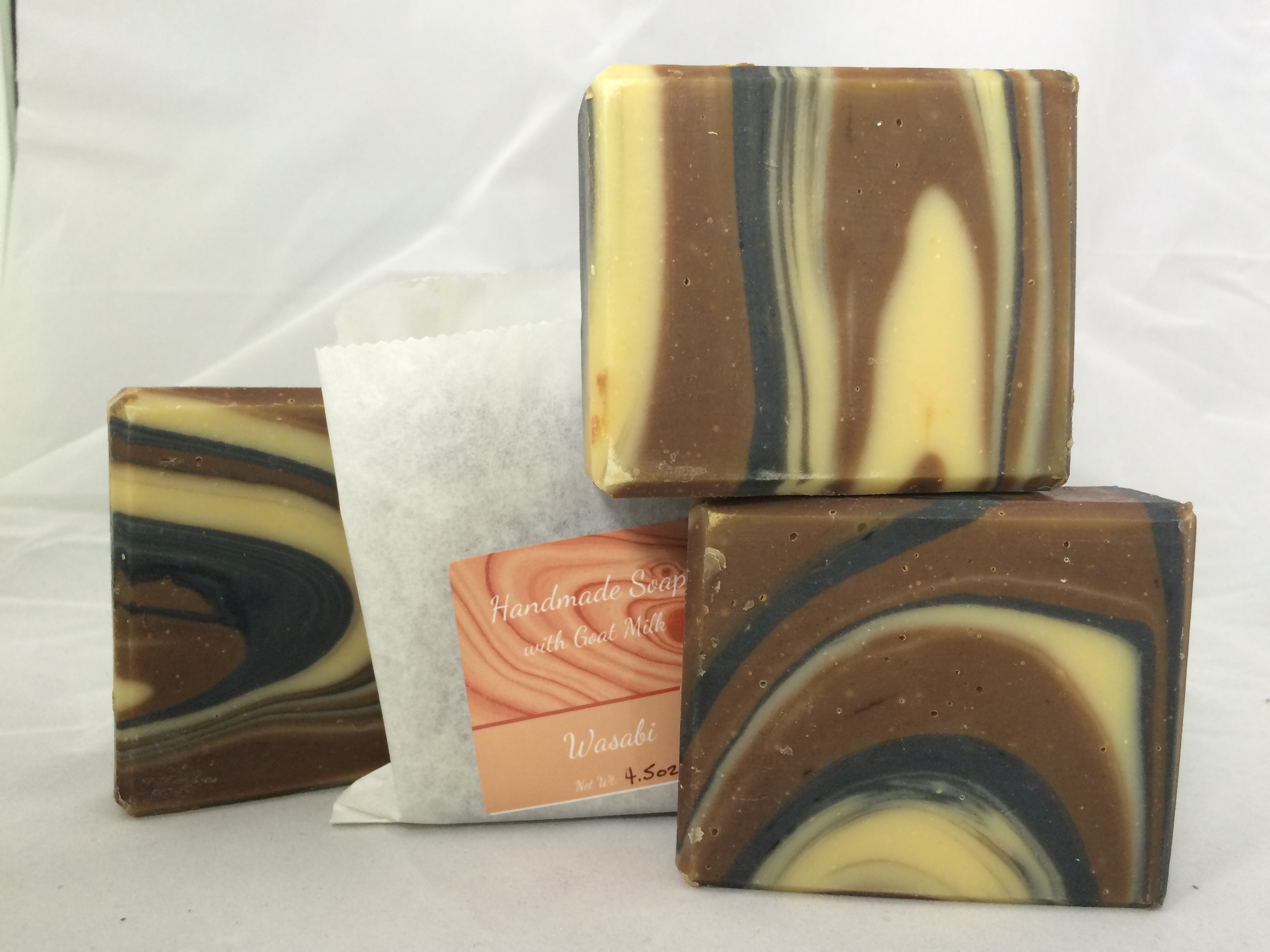 handmade soap with wood grain pattern and wasabi fragrance